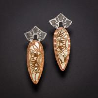pair of earrings  Julie Packer on a dark background